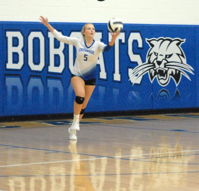 Cambridge senior Kensley Taylor serves for the Lady Bobcats during Thursday's Senior Night victory over Warren High.
