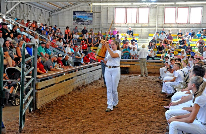 In this Daily Record file photo, a stave barrel style butter churn is up for grabs at the dairy products auction in the Coliseum at the Wayne County Fair.