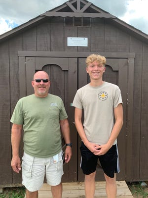 Jeff Battig, left, recreation and community center manager for the  City of Wooster, with Quinn Fannin and Fannin's Eagle Scout project — a new shed on the Wooster Soccer Association fields.