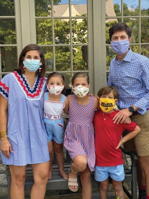 Columbia Mayor Chaz Molder, his wife, Liz, and children wear masks to combat the coronavirus outbreak.