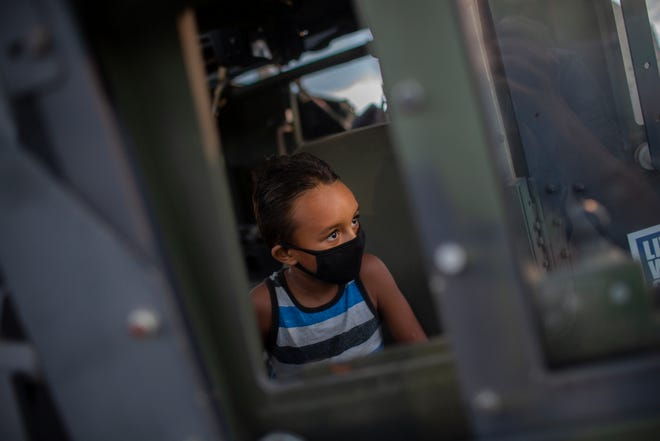 Aries Jimenez, 6, explores a Humvee on display by the U.S. Army National Guard at the Maury County Fair and Exposition at the Maury County Park in Columbia, Tenn., on Thursday, Sept. 3, 2020.