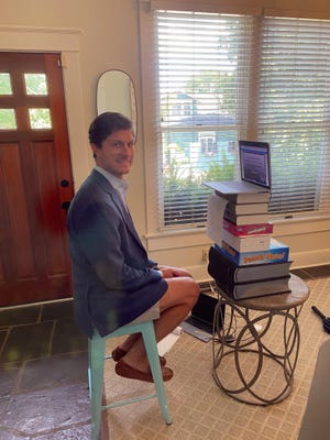 Columbia Mayor Chaz Molder improvises to work from his living room after being diagnosed in July with the coronavirus.