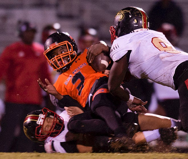 North Davidson quarterback Tedric Jenkins is tackled after a long run against Salisbury in the 2019 season.