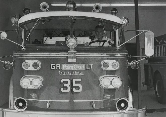 Palm Coast volunteer fire chief Charles Konopasek sits in the driver's seat of the fire truck that the ITT Community Development Corp. purchased in September 1978 to loan to the fire department for fire protection in the Palm Coast area. With the donation, the Volunter Fire Department was able to extend its protection area to a five-mile radius from the emergency services building.