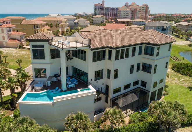 This 5-story oceanfront home on Ocean Crest Drive in the Hammock sold recently for $2.95 million. It has five bedrooms and 6 baths in 7,078 square feet of living space. Built in 2018 on the Nicklaus Oceanfront Golf Course, it also has two master suites, two home offices, three laundry rooms, an observation deck, a five-car garage, an elevator, a saltwater pool and spa, a summer kitchen and a deck with a fireplace.