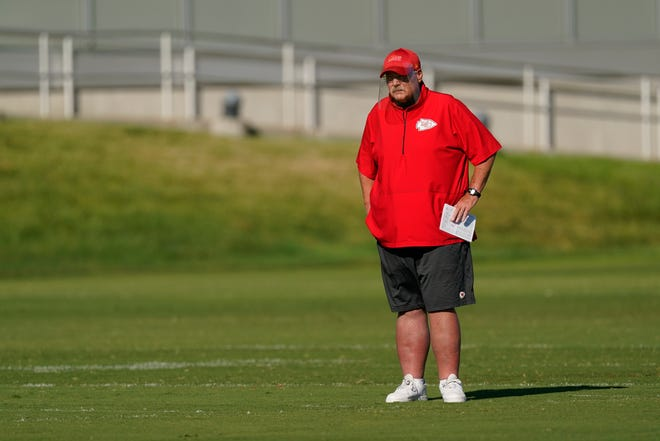 Kansas City Chiefs head coach Andy Reid watches workouts during training camp. Reid and Baltimore Ravens coach John Harbaugh, who worked under Reid in Philadelphia for 10 years, have remained good friends. Their teams will meet Monday night.
