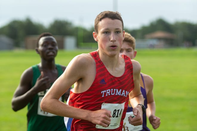 Truman's Josh Nunn runs to a victory in the Independence City Championship. The Patriots took five of the top 10 spots to claim the team title, and the girls team made it a sweep.