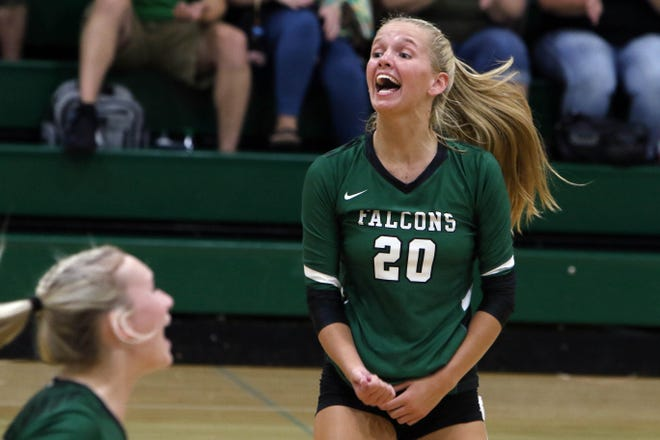 West Burlington High School's Sydney Marlow (20) celebrates a point during their match against Van Buren County, Thursday Sept. 3, 2020 at West Burlington.