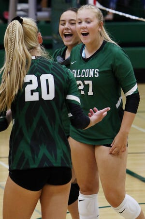 West Burlington High School's Isabelle Ritter (27) celebrates a point with teammates during their match against Van Buren County, Thursday Sept. 3, 2020 at West Burlington.
