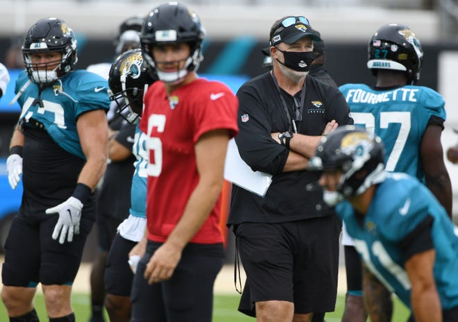 Head coach Doug Marrone looks over the activity on the field during a practice session in TIAA Bank Field.