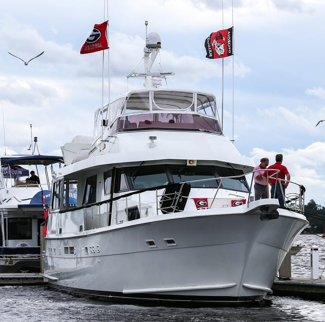Fans fly their team's colors at Metropolitan Park Marina before the Florida-Georgia game at TIAA Bank Field in Jacksonville in 2018.