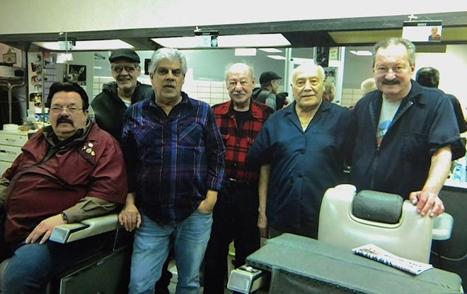 Barbers at Northfield Plaza Barbershop, which marked 60 years in Northfield Village in August, pose for this photo this past January. From left, Denny Kirksy, Phil Ross, Mike Spadro, Joe Gliozzo, Ignatius Lovano and owner Jim Jana.