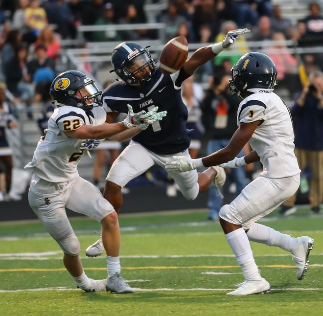 Twinsburg's Alex Branch breaks up a pass during a game against Solon last season. Branch is one of 14 returning starters for the Tigers.