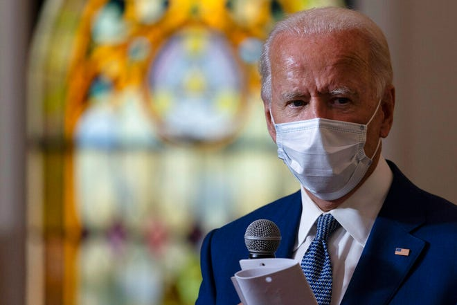 Democratic presidential candidate former Vice President Joe Biden meets with members of the community at Grace Lutheran Church in Kenosha, Wis., Thursday.