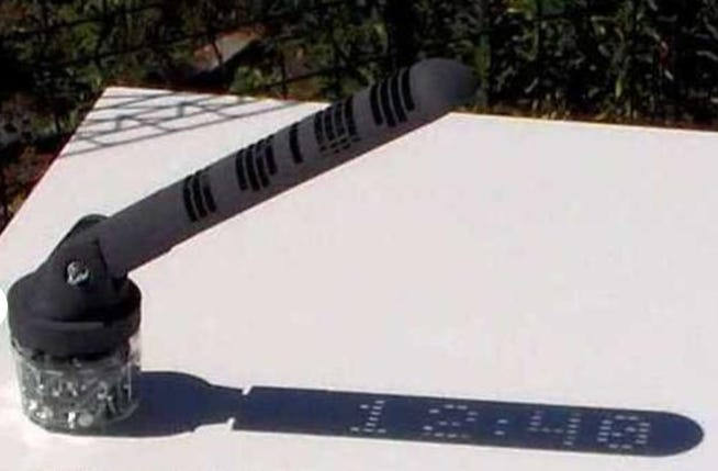 A digital sundial from Mojoptix.com shows the time in the form of a shadow displaying digits.