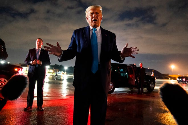 President Donald Trump talks with reporters at Andrews Air Force Base after attending a campaign rally in Latrobe, Pa., Thursday, at Andrews Air Force Base, Md.
