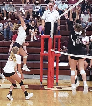 Oak Ridge High School volleyball senior Lynley Baldwin smashes ball over Bearden players in Tuesday's game against Bearden at home. Special to The Oak Ridger