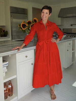Beth Buccini wears one of her own designs, the Olympia dress named after her daughter's the middle name.