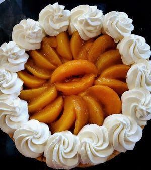 Peach cobbler cheesecake is on the menu at the Majestic Ash Lounge and Southern Spice restaurant in Northwood.  [Provided by Majestic Ash Lounge]