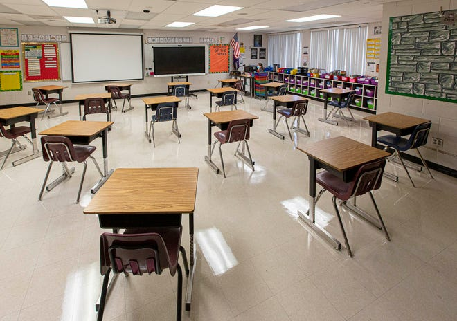 Student desks are placed 6 feet apart at Heritage Elementary School in Greenacres on Friday.