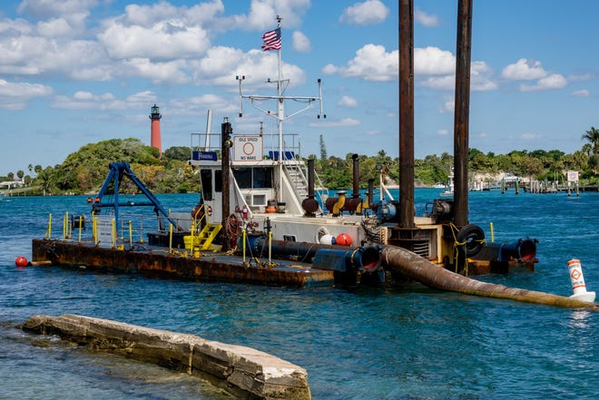The Jupiter Inlet District conducts a dredging project from the inlet near Dubois Park to Jupiter Beach Park on April 22, 2019 in Jupiter.  [RICHARD GRAULICH/palmbeachpost.com]