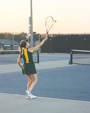 Pratt freshman Bailey Jackson serves to her opponent during an early season competition already this year. The Pratt High School girls tennis team is taking need of several new coronavirus-inspired safety rules, but playing tennis with a business as usual attitude and enjoying the opportunities of the season so far.