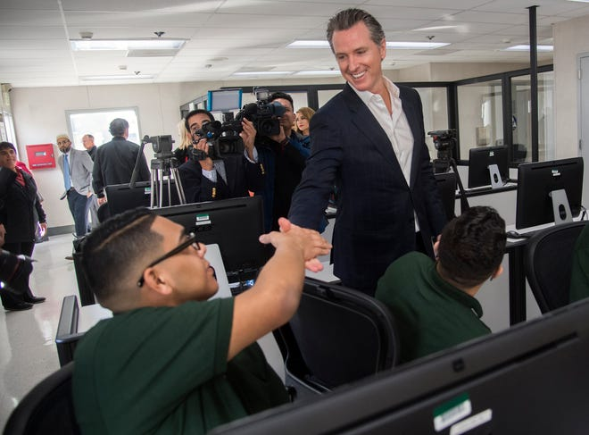 California Governor Gavin Newsom talks with juvenile wards at the grand opening of the Code.7370 computer coding training program at the O.H. Close Youth Correctional facility in Stockton on Jan. 22, 2019.