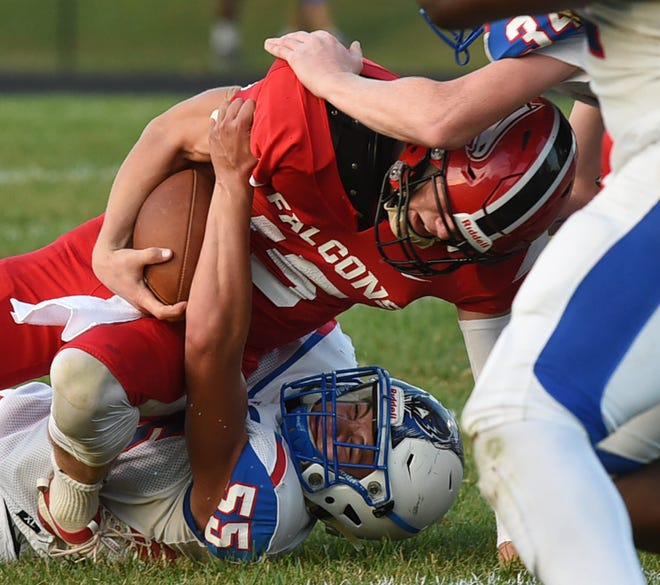 Field hosted Ravenna, football. Quarterback Dallas McAmis on a carry, tackled by Mario Frisone. Lisa Scalfaro, Record-Courier