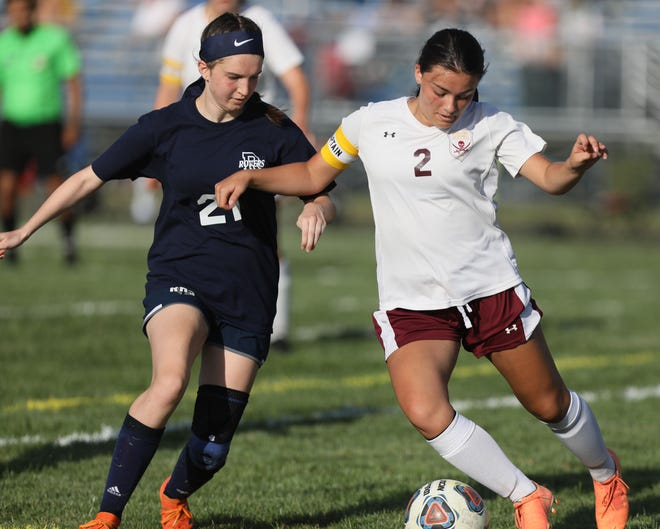 Southeast sophomore captain Payton Kittle, right, tries to make a move against Rootstown senior captain Esther Shackelford.