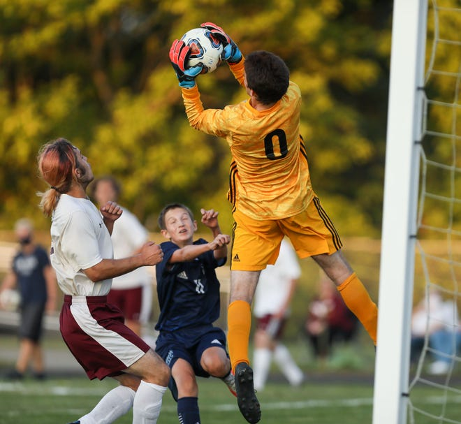 Southeast senior goaltender Dillon Boston makes a leaping save during the first half of Thursday night's game against Rootstown.
