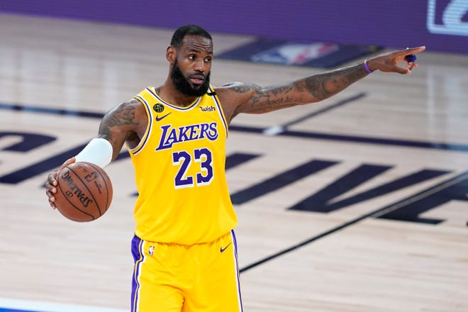 LeBron James leads the Los Angeles Lakers against the Houston Rockets in Game 1 of their Western Conference playoff series Friday night. (AP Photo/Ashley Landis)
