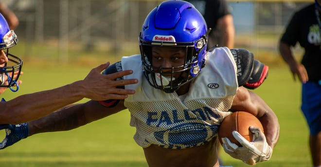 Menendez running back Duane Graham sheds an arm tackle during a Sept. 3 practice. Graham ran for 1,112 yards and 14 touchdowns in 2019. The Falcons did not lose a game when he found the end zone.