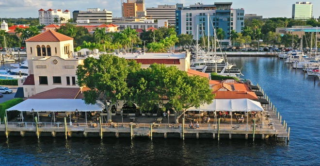 Pier 22, foreground, is on the Manatee River in downtown Bradenton. Oak & Stone occupies part of the first floor and the rooftop of the The Spring Hill Suites hotel, seen back right.