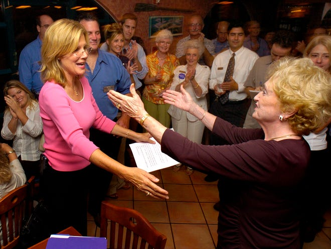 Outgoing Manatee County Commissioner Pat Glass, right, extends her congratulations to Carol Whitmore, who won her seat, during an election party at Twin Dolphins restaurant. HERALD-TRIBUNE ARCHIVE/2006