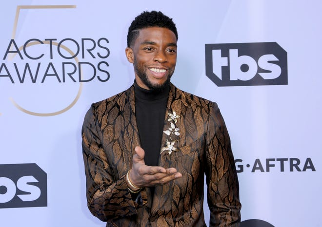In this Jan. 27, 2019 photo, Chadwick Boseman arrives at the 25th annual Screen Actors Guild Awards at the Shrine Auditorium & Expo Hall in Los Angeles.  Boseman, who played Black icons Jackie Robinson and James Brown before finding fame as the regal Black Panther in the Marvel cinematic universe, died Aug. 28 after a four-year battle with colon cancer. He was 43.