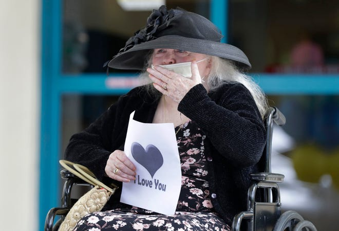 In this July 17 photo, Margaret Choinacki, 87, blows kisses to her friend during a drive-by visit at Miami Jewish Health in Miami. Gov. Ron DeSantis announced Sept. 1 that Floridians will be allowed to visit loved ones in nursing homes after nearly six months of vulnerable seniors being cut off from family.