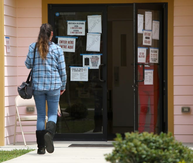 A voter walks up to a poling place in Gainesville.