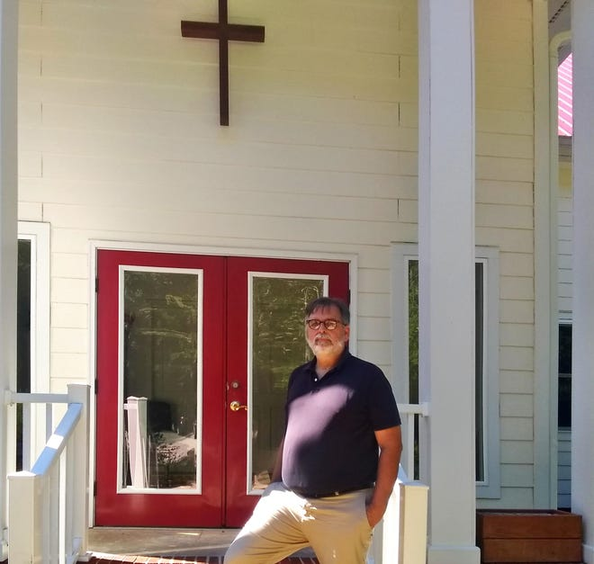 JayKennett, a pastorat Hillsborough United Church of Christ, posed outside his church. Kennett is a proponent of using churches as sanctuaries for illegal immigrants under threat from federal law enforcement.