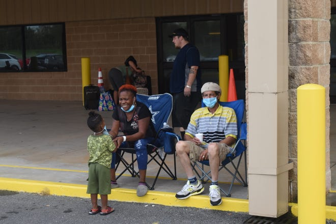Patricia Lavergne (left) has been staying at the Alexandria Mega Shelter with her husband, Kenneth Lavergne, and grandson, Ahmir Mingo. The shelter is a reception center for Hurricane Laura evacuees. Officials are registering evacuees at the site, and then sending them on to hotels in New Orleans.