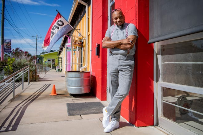 J. Hackett stands outside the coffee shop he will be opening with business partner, Gene Ettison, in the River Arts District. Grind Coffee Co., which will also act as a coworking space and will seek to nurture entrepreneurship with additions like mailboxes, will be the first Black-owned coffee shop in Asheville.