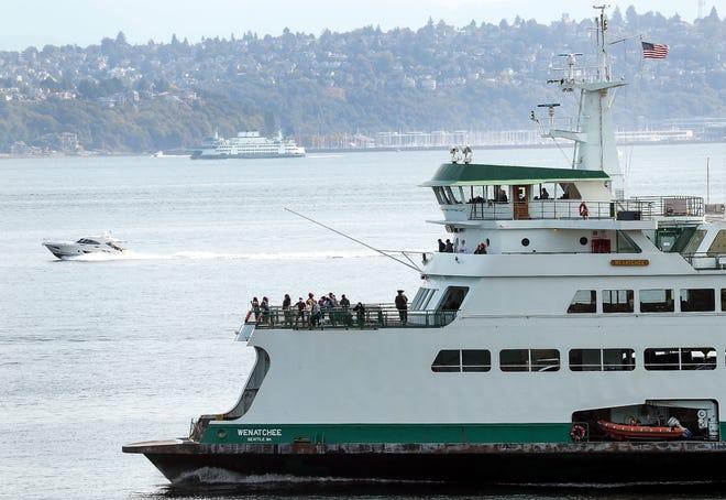 The Washington State Ferries vessel Wenatchee heads for Bainbridge Island's Eagle Harbor on Friday, Sept. 4, 2020.