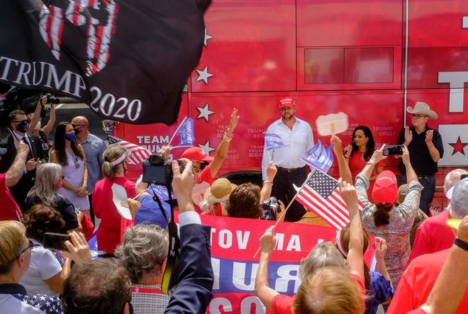 Trump supporters greeted campaign surrogates — former campaign manager Brad Parscale, senior adviser Katrina Pierson and Texas Lt. Gov. Dan Patrick — during a bus tour stop Thursday in San Antonio.