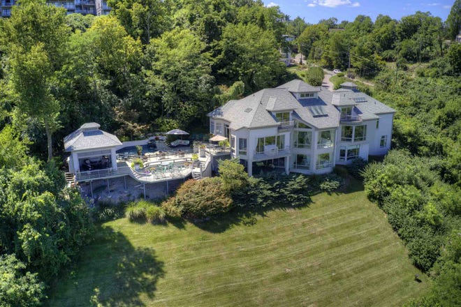 This 10,000-square-foot hillside estate in Covington's Kenton Hills neighborhood recently hit the market for $2.95M