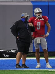 Detroit Lions quarterback Matthew Stafford speaks to manager Matt Patricia during training at Ford Field on Tuesday, September 2, 2020.