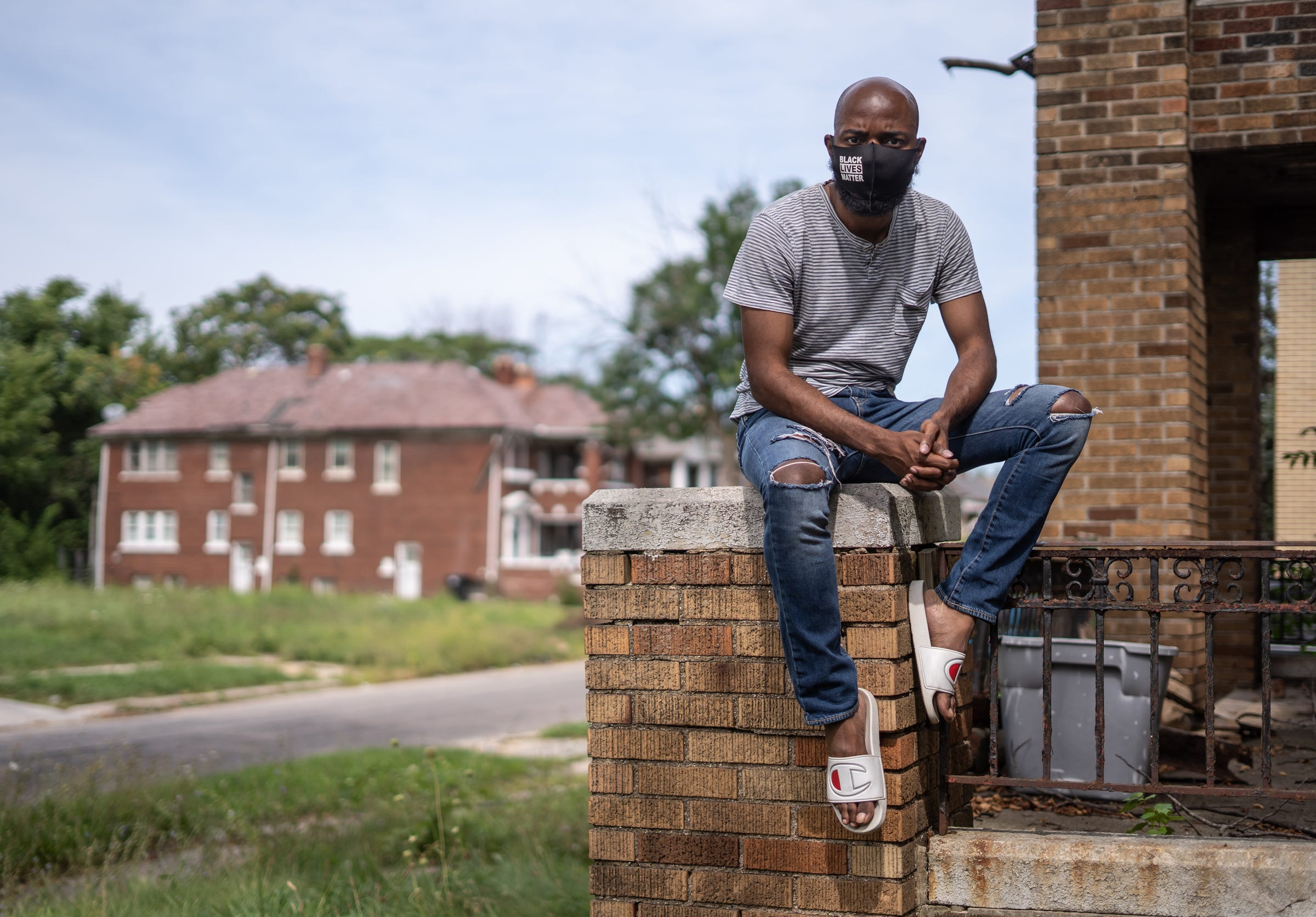 """Fernando Willis Jr. of Detroit poses for a photo at the home he grew up in on Gladstone Street on Detroit's North side on Tuesday, August 25, 2020. Willis Jr. got involved with the Detroit Will Breathe movement after the pandemic made it unsafe for him to put volunteers at risk while feeding the homeless with his nonprofit Senseless Acts. """"Some people believe its too much to risk and why do it anyway? Because here we are it's two thousand twenty and we are still fighting for things that we've been fighting for when I was born, before I was born, before my mom was born. They talk about in the church generational curses. This is the biggest one I've ever seen. Racism, the injustice, the issues that we still face to this day. So I understand that some of my people cannot fight. Some of my people don't understand why fight anyway. Some feel powerless. Some feel conditioned and I know what that's like. I'm not this person who who believes. I know so much. I know it all. I'm still learning as I go,"""" Willis Jr. said. """"I fight for those who are not fighting back and I carry them on my back and I carry that burden. I carry that responsibility with me and I carry on with my other brothers and sisters who are physically there, but also not there. They are always with us whether it be investors, whether it be someone to say yes Black lives do matter. And that's why I march. I believe Detroit will win this fight. Detroit deserves better. My people deserve better and I know that Detroit will breathe. It's a little suffocated right now because of the foolishness, because of the evil and toxicity of the city of Detroit and how the leadership is handling everything. A little suffocating. But we will breathe. We will breathe, and my people will be free."""""""