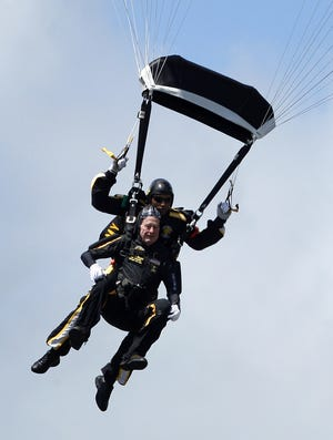 Former President George H. W. Bush rides tandem with Army Sgt. Michael Elliott of the U.S. Army Golden Knights parachute team as he celebrates his 85th birthday with a parachute jump, Friday, June 12, 2009, in Kennebunkport, Maine. Thursday, Fremont City Schools Superintendent Jon Detwiler, Port Clinton City Schools Superintendent Pat Adkins and  Cory Stine, executive director of the Terra College Foundation, will do tandem skydive jumps with the Golden Knights at Wadsworth Municipal Airport.