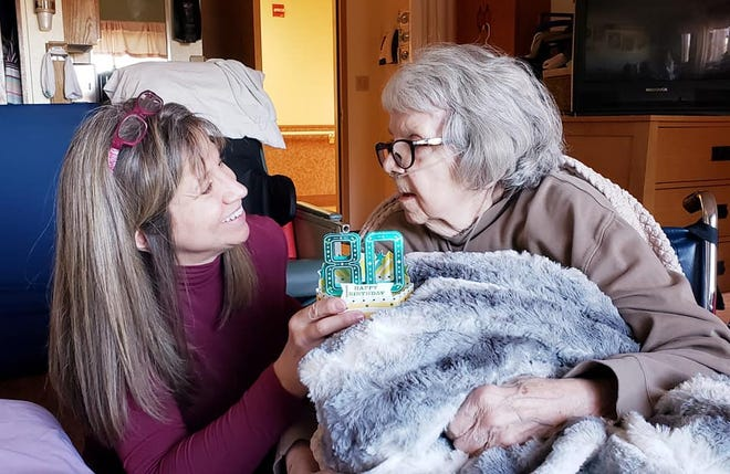 Tara Schulze, left, celebrates her mother Zorah Hurd's 80th birthday at Estes Park Health Living Center. Estes Park Health System, which owns the center, is considering closing it down amid financial woes brought on by the COVID-19 pandemic.