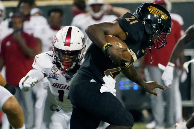 Southern Mississippi running back Frank Gore Jr. (21) gets away from South Alabama linebacker Roy Yancey (14) during the first half of an NCAA college football game in Hattiesburg, Miss., Thursday, Sept. 3, 2020. (AP Photo/Rogelio V. Solis)