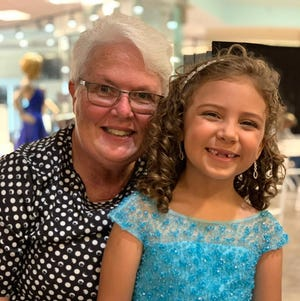 Pam Carr poses with her granddaughter, Christine, at a beauty pageant in Kentucky on Sunday, Aug. 30, 2020. Carr, of Sevierville, made the trip to support her granddaughter three days before Carr's death.