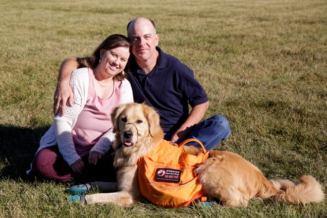 Sarah Trueb and Derek Douglass sit with Derek's service dog, Rosco, Friday, Sept. 4, 2020 in Lafayette. Now engaged, Douglass and Trueb first met after Douglass was profiled in a 2018 People Magazine story.